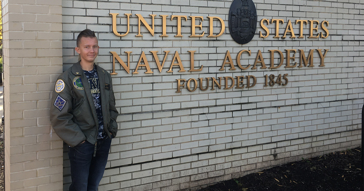 Ryan Cleasby in front of U.S. Naval Academy sign