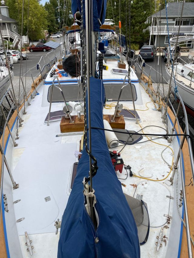 1989 Ct 56 foot Ta Chiao sailboat with white embossed SeaDek being installed.