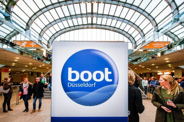 boot Dusseldorf image if logo and people walking in the background.