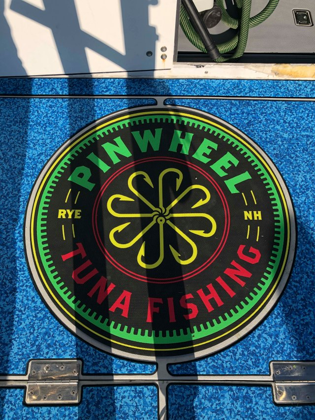 The deck of a boat with a Pinwheel Tuna Fishing logo made by SeaDek.