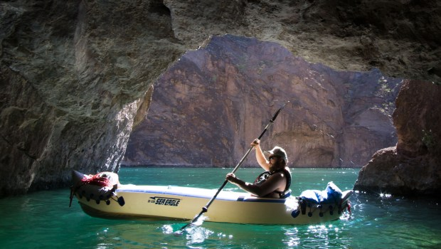 "Ryan explores Emerald Cave in Black Canyon. ""At a certain time of day, the sun come in and lights up the water, turning it an emerald green."""