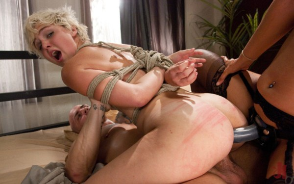 Tied up blonde gets a double penetration by a cock and a strap on