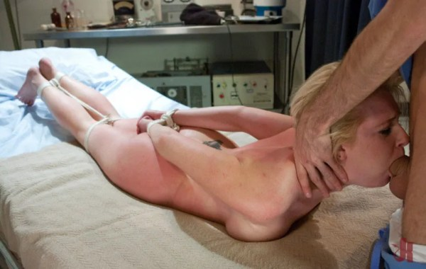 Blonde patient is tied up and has her throat fucked by her doctor