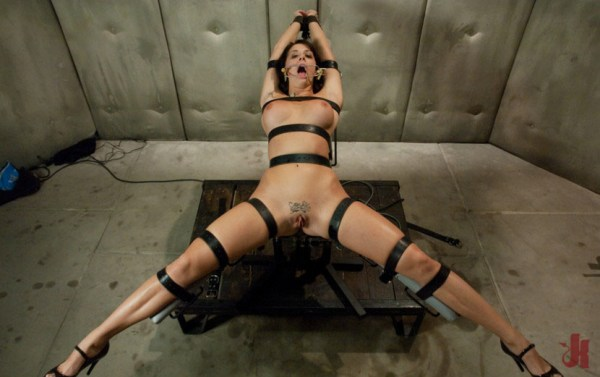 Cock-hungry brunette is bound in leather straps and wears mouth spreader in extreme sex