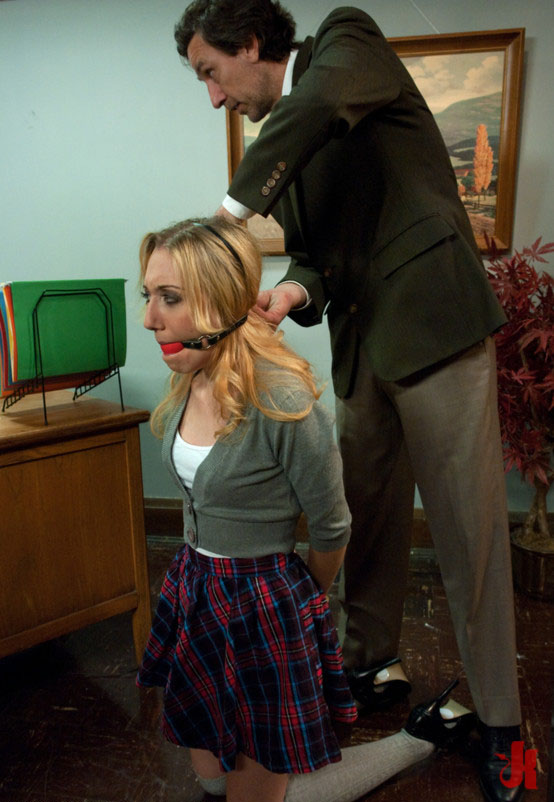 Naughty blonde pupil is punished, put on her knees and has put on her a red ball gag