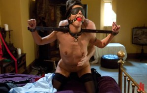 Blindfolded and gagged brunette has an iron device on and is fucked hard from behind