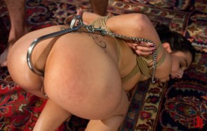 Brunette is tied up, put on the floor and has an anal hook inserted