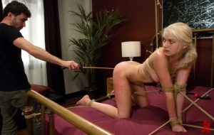 Dominating young man ties up a younger blonde on his father's bed and canes her ass
