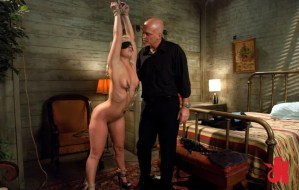 Submissive blonde on high heels is blindfolded has nipple clamps and gets teased by a man