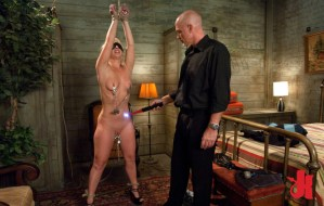 Tied up and blindfolded, submissive slut has nipple clamps and gets shocked by a dominating man