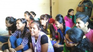 VI girls sitting in a group laughing