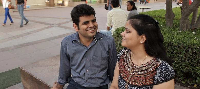 A still from the documentary Accsex. A couple sits together smiling.