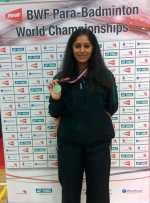 Manasi Joshi holding a medal.