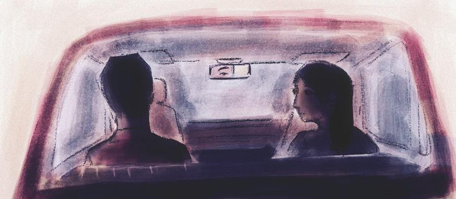A man and woman are sitting in the back of a car. The man is looking straight ahead so that we only see the back of his head, and one eye reflected in the rearview mirror, but the woman is turned towards the man.