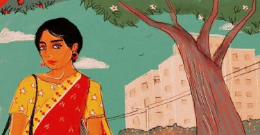 A person wearing a red and yellow sari stands towards the left of the image, head turned, looking forward. In the background are trees, buildings and the blue sky.