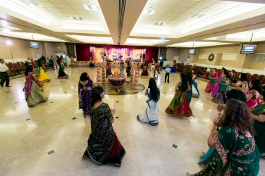 People dancing gara at an Indian wedding sangeet at the Jain Center of Southern California