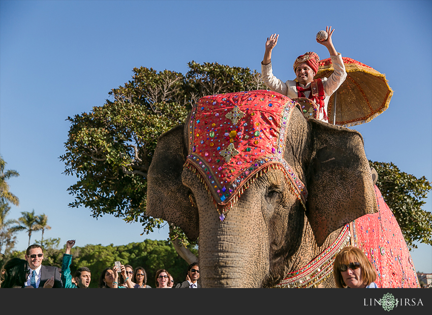 Groom on an elephant at his Indian wedding baraat in Southern California