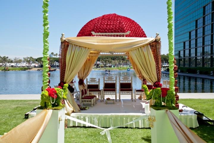 Dome, 4 pillar mandap style for an outdoor Indian wedding.