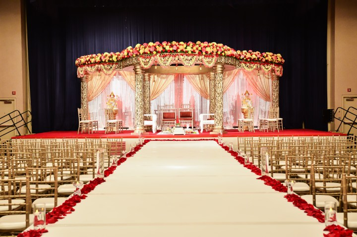 Large mandap style at an indoor Indian wedding.