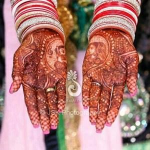 Beautiful mehndi on the hands of an Indian bride wearing chura