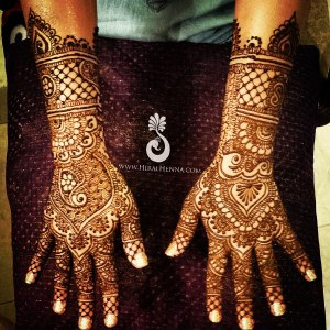Very detailed mehndi design by Hiral Henna on an Indian bride's hands