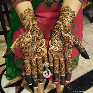 Detailed mehndi on a bride's hands