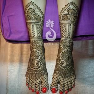 Traditional Rajasthani mehndi on an Indian bride