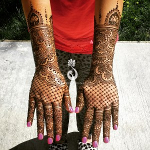 Mehndi by Hiral Henna on an Indian bride's hands and arms