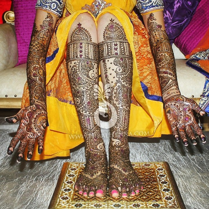 Very heavy coverage of mehndi on an Indian bride
