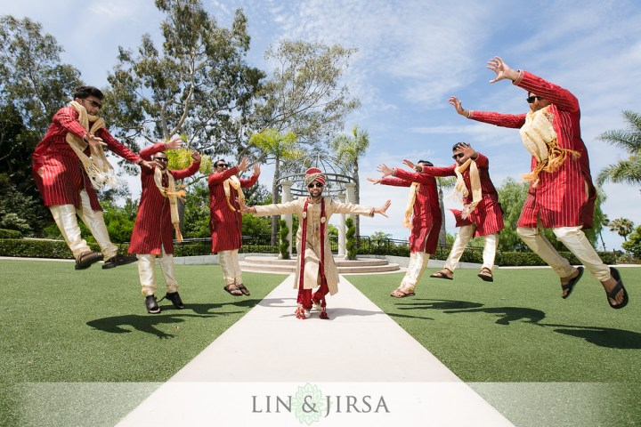 An Indian groom showing the power of Thor with his groomsmen in a funny wedding photo