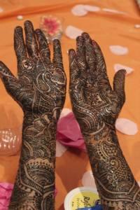 Intricate mehndi design by Neha Assar on an Indian bride's hands