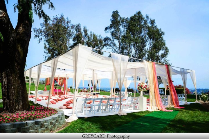 Sikh Indian wedding canopy and flooring on the grass for an outdoor Anad Karaj.
