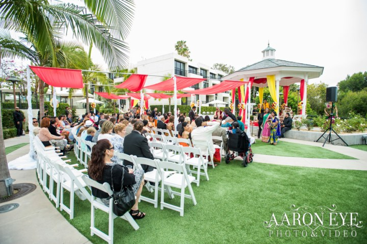 Guests seated for an Indian wedding at the Rose Garden venue at the Marriott Newport Beach.