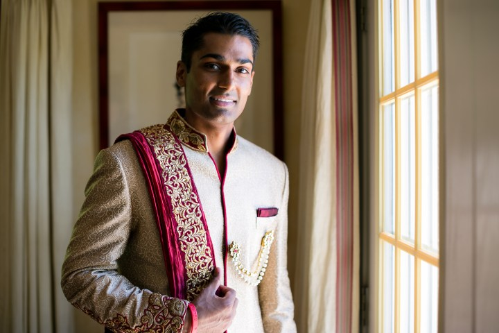 Indian Gujarati grom posing for a shot before his baraat and Indian, Gujarati Hindu wedding ceremony
