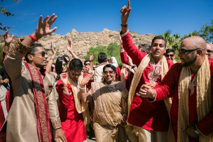 guests dancing at the baraat at Gujarati Indian wedding