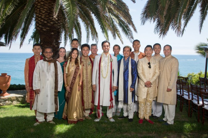 Indian groom standing with his friends at his wedding with friends wearing kurtas for the wedding.