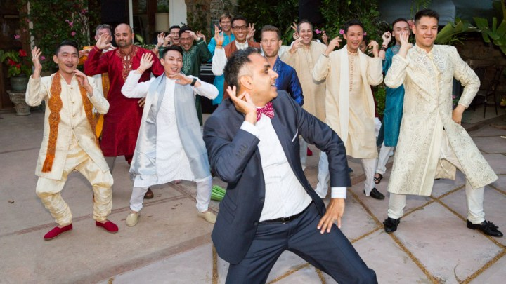 guy leading a flash mob at an Indian wedding