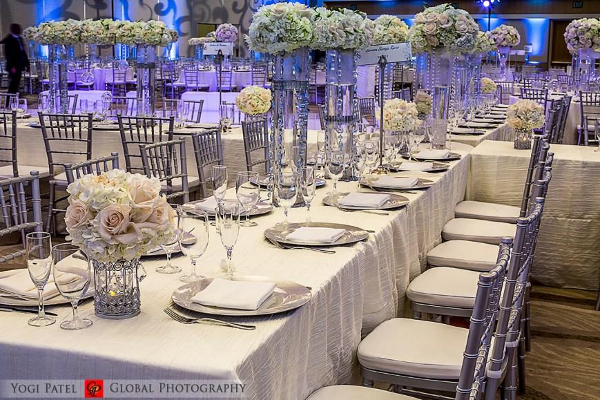 Indian-wedding-pink-lehenga-sherwani-sera-Hotel-Irvine-dupatta-Global-Photography-Kunal-Shveta-charger-plates-centerpieces