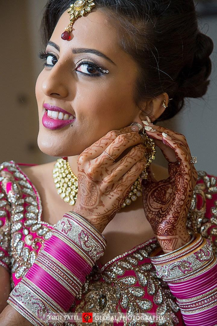 Indian-wedding-pink-lehenga-sherwani-sera-Hotel-Irvine-dupatta-Global-Photography-Kunal-Shveta-tikka-chudiyan-kalire