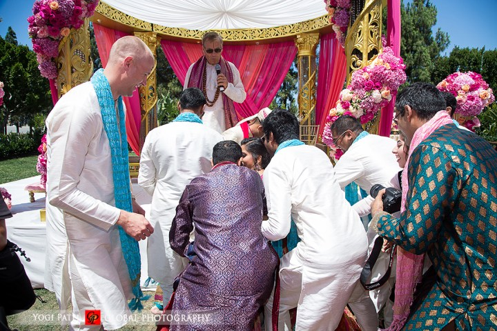 Indian wedding stealing the grooms shoes at Hote Irvine at this Punjabi Jain wedding.