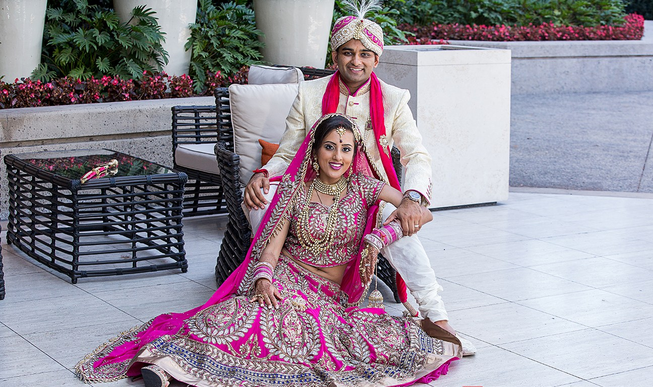 Indian wedding at Hotel Irvine. The bride and groom in their Indian wedding dresses ready for their Hindu wedding ceremony.