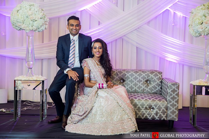 Punjabi indian bride and groom during their photoshoot for their indian wedding reception.