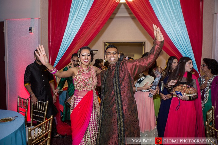 Bride and groom at their sangeet for an Indian wedding