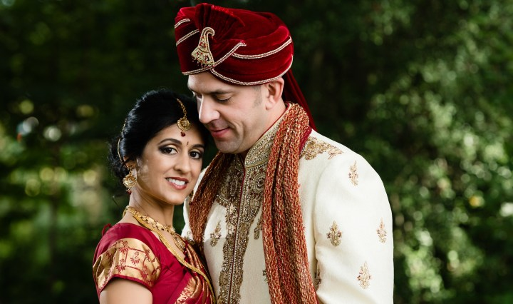 Bride and groom at their Indian wedding ceremony. Their photoshoot was outdoors and the ceremony was indoors.