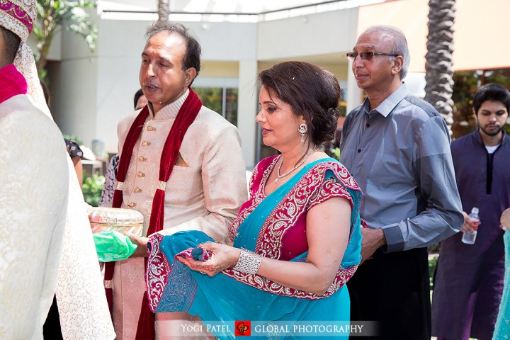 Indian wedding vida, bhabhi catching the rice in her sari.