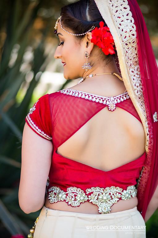 back of the bride's red lehenga choli blouse