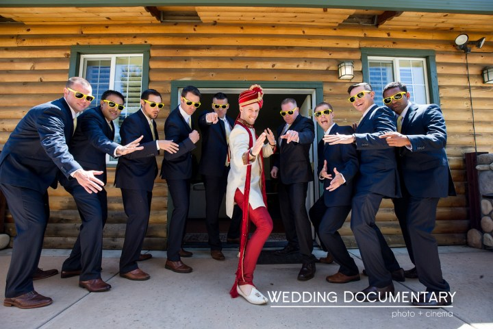 The groom wearing his kurta and sehra in a funny photo with the groomsmen.
