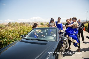 Indian wedding baraat. Girls getting bosted into the convertible