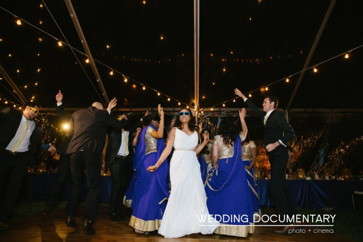 The bride dancing with her bridesmaids at her Indian fusion wedding