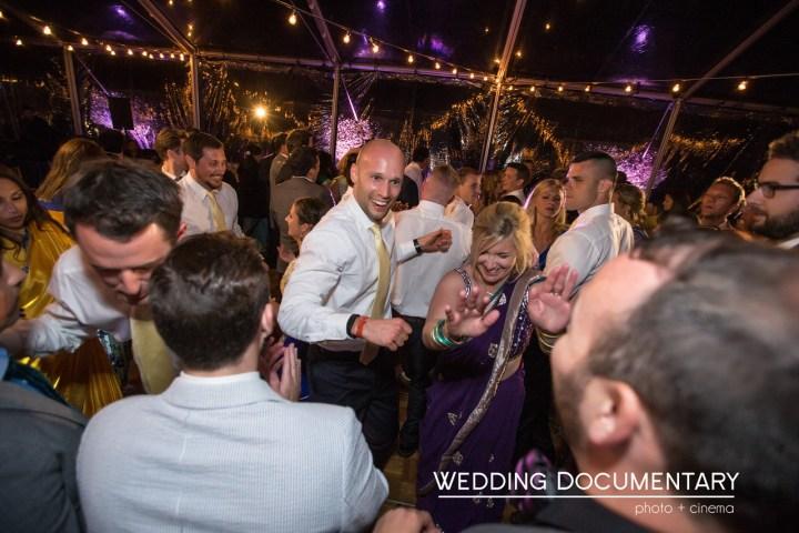 Groom dancing at his outdoor Indian wedding reception